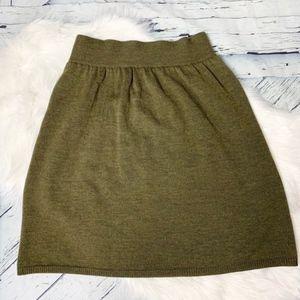 Eileen Fisher green knit a-line shirt.